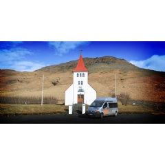 Campervan in front of a church in Iceland