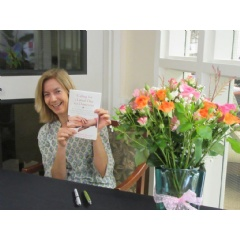 Memory care expert and Licensed Clinical Social Worker (LCSW) Marguerite Manteau-Rao, signs copies of her new book at Lakeside Park memory care community in Oakland, Calif.