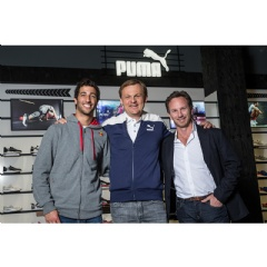 Björn Gulden, Chief Executive Officer for PUMA, Christian Horner, Team Principle of the INFINITI RED BULL RACING team, and Daniel Ricciardo, driver of the INFINITI RED BULL RACING team
