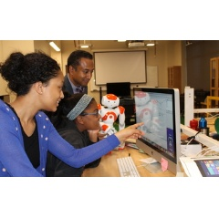 A student works in the Choreographe visual programming environment used to program humanoid robots.