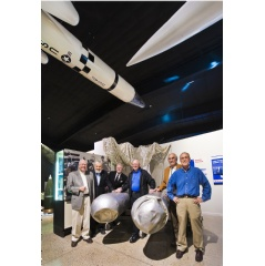 Six active and retired Sandia National Laboratories employees gathered in 2011 at the National Museum of Nuclear Science & History in Albuquerque, NM, around two B28 gravity bombs recovered from a 1966 nuclear accident. (Photo by Randy Montoya)