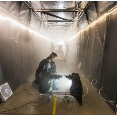 Sandia National Laboratories developed a fog chamber to test optics, like security camera sensors, in a controlled environment. (Photo by Randy Montoya)