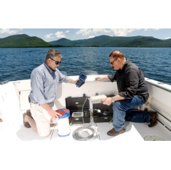 IBM Research scientists Mike Kelly (left) and Harry Kolar (right) deploy an array of sensors that capture data which will be analyzed to help manage and protect New York's Lake George. (Credit: Feature Photo Service for IBM)