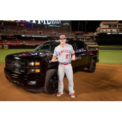 2015 MLB All-Star Game Most Valuable Player Mike Trout of the Los Angeles Angels of Anaheim poses with the MVP trophy and a Chevrolet Silverado Midnight Edition, the prize for his MVP win. (Photo by LG Patterson/MLB Photos via Getty Images)