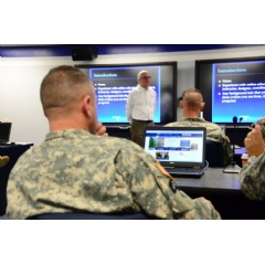 The soldiers in the first class of the U.S. Army Sergeants Major Academy Fellowship program attend an orientation hosted by Penn State adult education professor William Diehl.