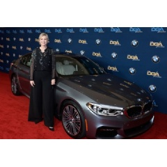 BMW partners with the Directors Guild of America for the 69th Annual Directors Guild Awards. Jane Lynch, host of the evening, with the all-new BMW 5 Series Sedan on the red carpet.