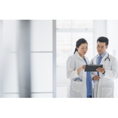 Clinicians view patient data on tablet