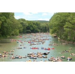 Guadalupe River Tubing on the famous Horseshoe Loop in Canyon Lake, Texas - photo courtesy of the Tube Haus - The Guadalupe River reopens for river tubing on July 2nd, 2015 just in time for the 4th of July weekend.
