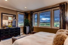 The Umbria model's serene master suite looks out on rolling hills and big, Colorado sky.