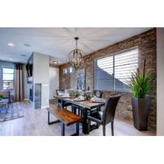 "The Bluebird plan is featured as the model home at Park Hill Village and shows a spin on urban living with its ""industrial chic"" interior design."