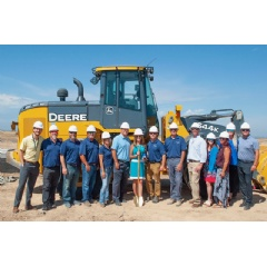 Epic Homes founder and owner, Christina Presley (center) and the entire Epic Homes team celebrate the groundbreaking of their newest home collection in the Painted Prairie community in Aurora, CO. Pre-sales for Epic Homes will begin in the fall.