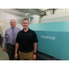 Gary O'Toole, left, General Manager of the Finishing Plant, and Chad Tillery, Pressroom Manager, proudly stand next to their J Press 720S, at Walsworth's Marceline, Missouri facility.