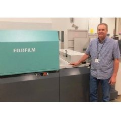 Brian Tilot, VP of Manufacturing, Independent Printing, proudly stands next to the J Press 720S at their De Pere, Wisconsin production facility.