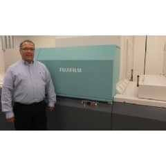 Jeff Hernandez, VP, Classic, proudly stands next to Fujifilm's J Press 720S at their Broadview, Illinois production facility.
