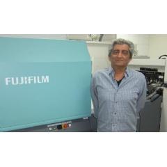 Sam Sowlaty proudly stands next to his Fujifilm J Press 720S, at his Los Angeles, California facility.
