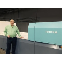 Raymond Ballew, VP of Administration, Floor Productions, proudly stands next to Fujifilm's J Press 720S, at their Dalton, Georgia facility.
