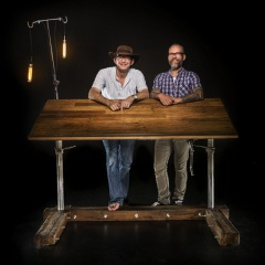 Zoo Studio director, Ken Drake and Custom Industrial founder, Durwin Lambe standing with the Drake Desk.