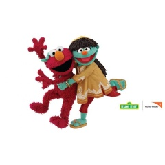 Raya (right) one of the newest members of the Sesame family, along with her friend Elmo (left), will teach children and families about positive health behaviors related to water, sanitation and hygiene.