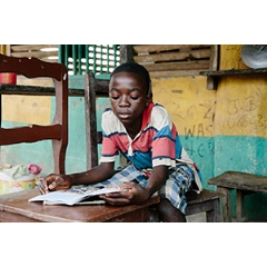 Joshua* is looking forward to returning to school after classes were shut down for months during the Ebola crisis. Photo credit: Aubrey Wade.
