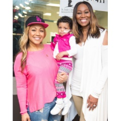 Gospel singer Erica Campbell (left) and celebrity radio host Yolanda Adams (right) helped lift the spirits of 3–year–old St. Jude patient Bella during the eighth annual Radio Cares for St. Jude Kids national broadcast event.