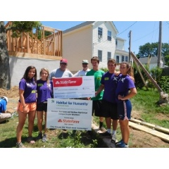 Brothers Chris and Greg Thomas, State Farm agents in New Jersey, present Habitat campus chapters with disaster services grant.
