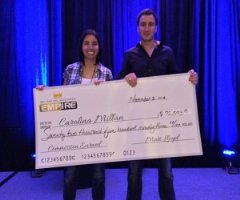 My Top Tier Business (MTTB) member Carolina Millan receiving a commission check from CEO Matt Lloyd
