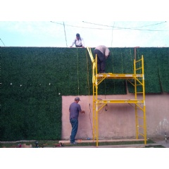 Geranium Street workers install artificial hedge in North Hollywood