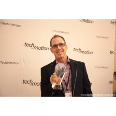 Drawbridge VP of Marketing Brian Ferrario accepts the Tech in Motion Silicon Valley Timmy Award for Silicon Valley's Best Technology Work Culture