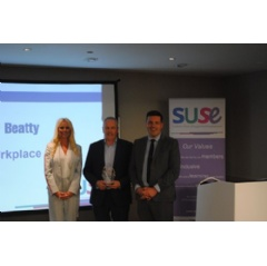 Balfour Beatty receiving award from Jamie Hepburn on behalf of SUSE  -CREDIT: Balfour Beatty-