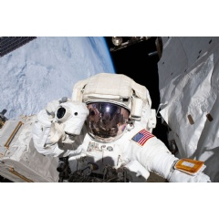 NASA astronaut Andrew Morgan prepares to take a photograph while conducting a spacewalk outside the International Space Station Nov. 22, 2019. Credits: NASA
