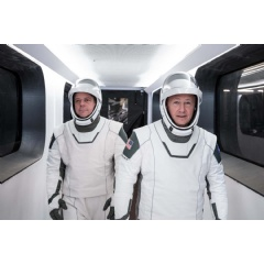 NASA astronauts Bob Behnken, left, & Doug Hurley, wearing SpaceX spacesuits, walk through the Crew Access Arm connecting the launch tower to the SpaceX Crew Dragon spacecraft during a dress rehearsal at NASA... Credits: SpaceX (Complete caption below
