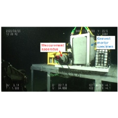 Measurement apparatus next to cement mortar specimen at a water depth of approximately 3,500 meters (Copyrighted image courtesy of JAMSTEC)