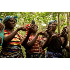 Women conducting community mapping in Democratic Republic of the Congo (Photo courtesy of Leo Bottrill of Moabi)