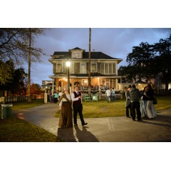 Historical re-enactors stroll the park at the Candlelight Tour, part of the Houston Historical Holiday Weekend event.
