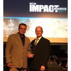 NEO Tech's Art Campos and Wayne Fite accepted the ECN Impact Award on behalf of the company.