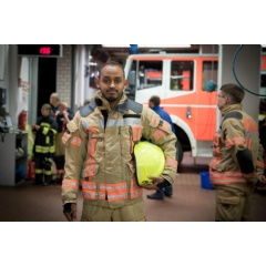 Somali refugee and volunteer firefighter Yusuf, 37, dons his uniform at the fire station in the town of Fürstenwalde, eastern Germany.  © UNHCR/Christian Mang