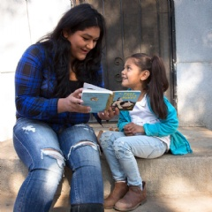 Rosa reads with her daughter, Surena, 4, during a home visit as part of Save the Children's signature Early Steps to School Success program in Central Valley California. Photo by Tamar Levine for Save the Children.