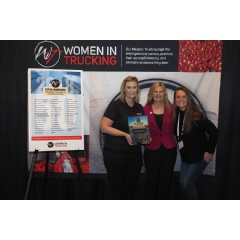 Jensen (left) and Young (right) accept Navajo's award from Voie (middle) at the 2018 Women in Trucking Accelerate! Conference.
