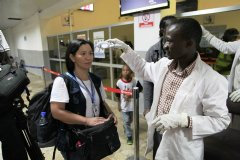 A WHO staff gets her body temperature checked at Lugin Airport, Freetown, Sierra Leone. Photo: WHO Sierra Leone