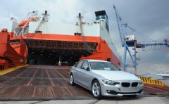 BMW vehicles coming off of the Wallenius Wilhemsen Logistics vessel during the official opening of BMW's newest Vehicle Distribution Center on September 18, 2014 in Baltimore, Maryland. (Photo by Larry French/Getty Images for BMW)