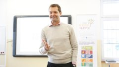 Tesco Slovakia CEO Martin Dlouhy introduces a workshop at a secondary school in Bratislava designed to help young people develop soft skills