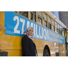 UNICEF Goodwill Ambassador Muzoon Almellehan stands for a portrait near a bus in the convoy of 27 empty school buses travels through the streets of Manhattan to shine a spotlight on 27 million out-of-school children living in conflic