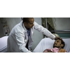Dr Ahmed al Jouneid, head of the emergency department, tends to a patient at the Al Koweit university hospital in Sana'a.