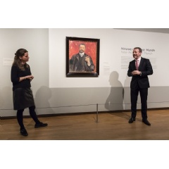 Museum director Axel Rüger and curator Maite van Dijk next to Edvard Munch's portrait of Felix Auerbach (1906). The portrait is the latest purchase for the Van Gogh Museum's collection and will be exhibited in a special new display of paintings.