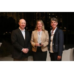 """Eganne Wolfington of Wolfington Body Company, Inc. accepts the 2017 Dealer of the Year award. She is flanked from Left to Right, by Ryan Kauffman (VP Sales, IC Bus) and Trish Reed (GM & VP, IC Bus)."