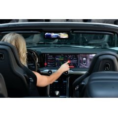 "A driver interacts with Watson Assistant within a ""digital cockpit"" from automotive electronics innovator HARMAN. (Alan Rosenberg/Feature Photo Service for IBM)"