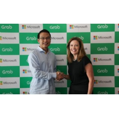 Ming Maa, president of Grab (left), with Peggy Johnson, Executive Vice President of Business Development, Microsoft.