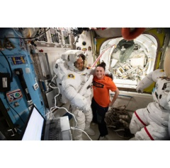 NASA astronaut Serena Auñón-Chancellor assists ESA (European Space Agency) astronaut Alexander Gerst with a spacesuit fit-check in preparation for spacewalks. Credits: NASA
