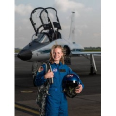 NASA portrait of 2017 Astronaut Candidate Zena Cardman in front of a T-38 trainer aircraft at Ellington Field near NASA's Johnson Space Center in Houston, Texas.