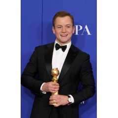 Taron Egerton, winner of Best Performance by an Actor in a Motion Picture - Musical or Comedy for Rocketman, poses in the press room during the 77th Annual Golden Globe Awards at The Beverly Hilton Hotel. (Photo by Kevin Winter/Getty Images)